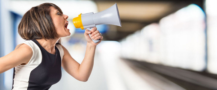woman promoting her business with megaphone